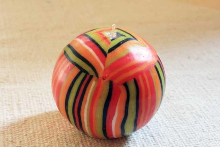 """Bougie artisanale du Swaziland """"Orange""""."""